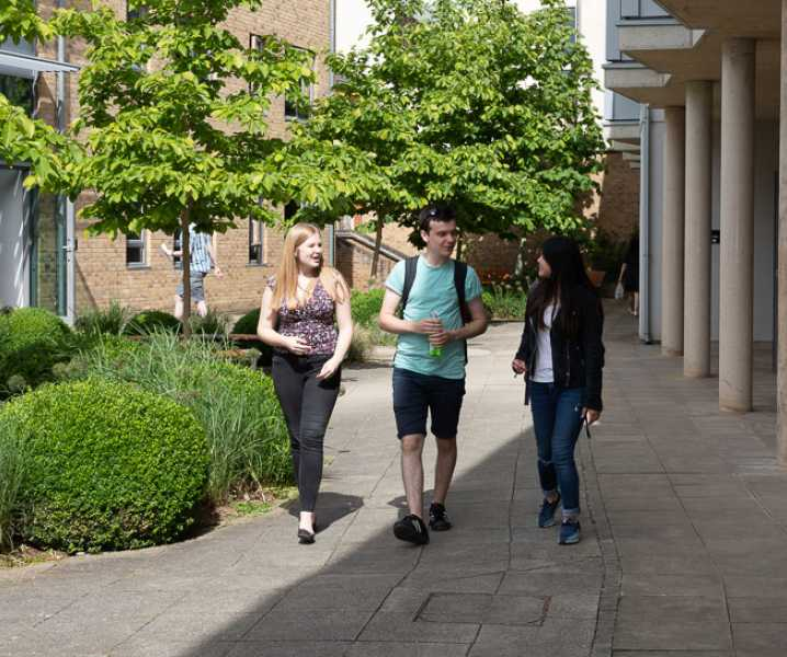 Worcester's undergraduate students walk through a courtyard by the Nash building