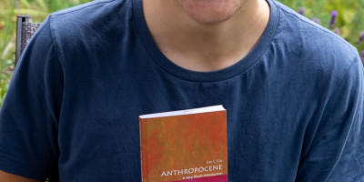 Alex holding the book