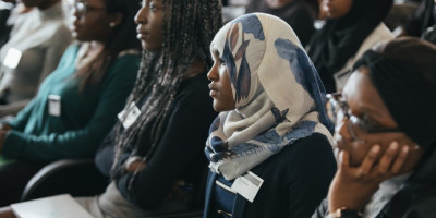 Students listen at an outreach event